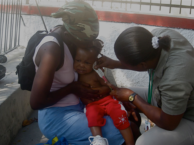 Concern nutrition officer Imacula Pierre with a patient.