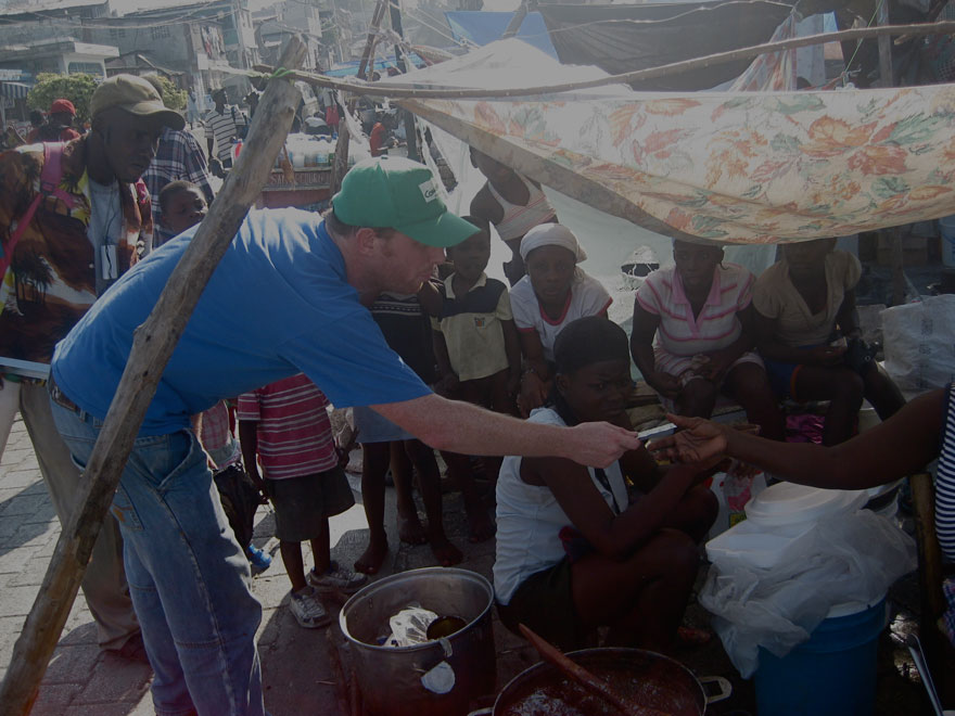 Phil O'Kelly distributes water purification tablets.