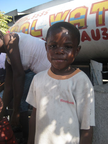 Young boy at Concern Water distribution.