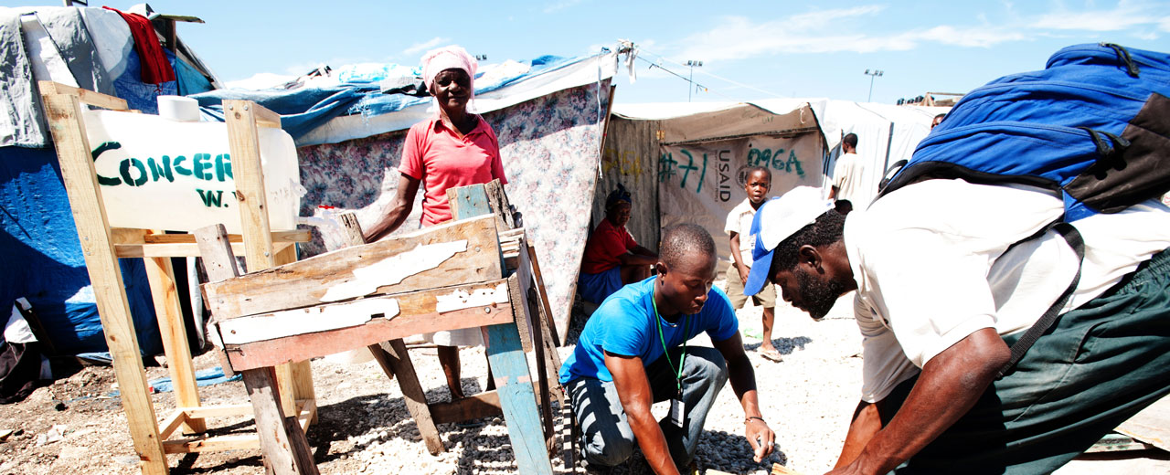 A temporary camp in Haiti after the 2010 earthquake, with a Concern Worldwide sign.