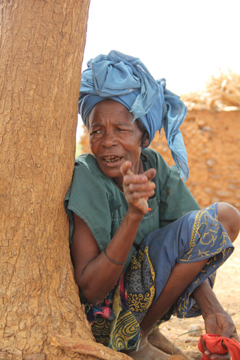 Zahi Amadou searched for millet grains in termite hills to get enough to prepare one meal for her family.