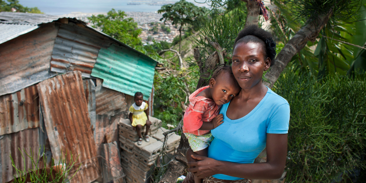 Christela Louis and her young children in Grand Ravine, one of Haiti's most notorious slums.