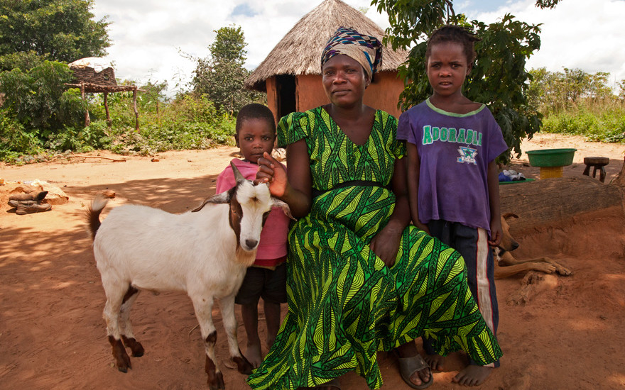 Catherine Mweene with her children and her new goat.