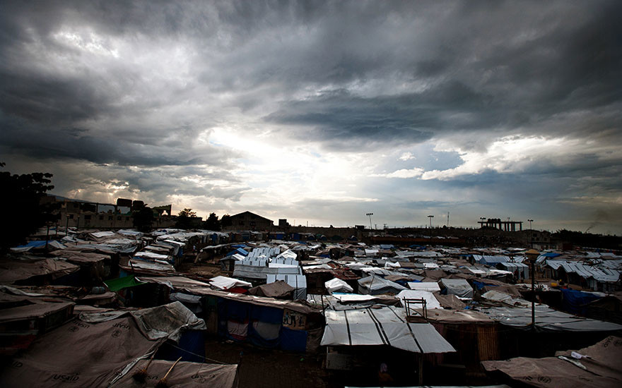 Storm clouds gather over the tent city in Place de la Paix, Haiti, in the aftermath of the 2010 quake.