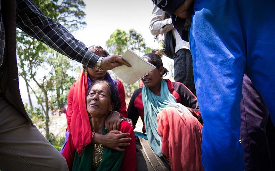 A woman sobs after a major aftershock rocked Nepal