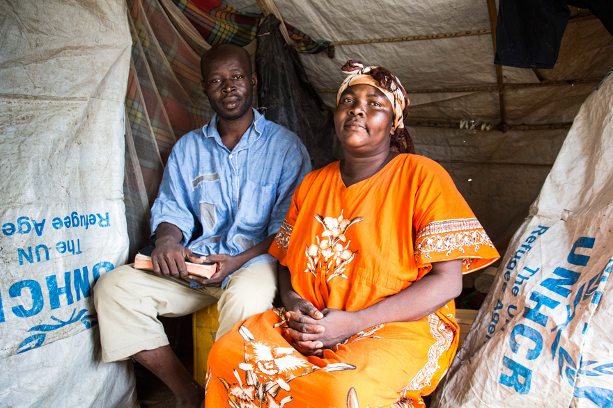 Gounandji Bienvenu, 39, and his wife, Damboy Charlotte, 38, sit inside their shelter in M'Poko displacement camp.