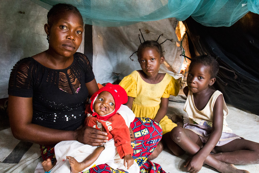 Mother and children inside their shelter in the M'Poko displacement camp.