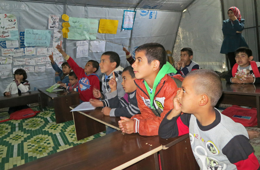 Kids in a makeshift tent classroom