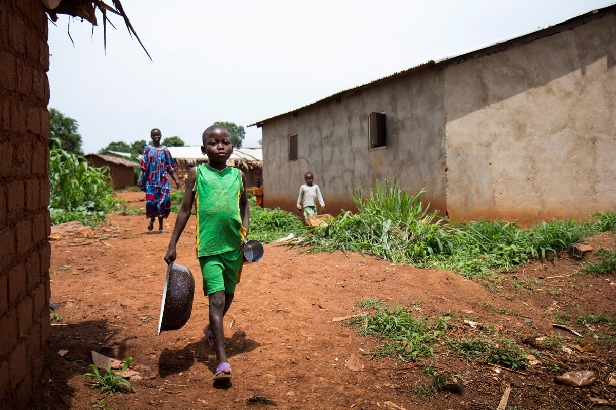 Wayele Dolo Arka sets off to collect water with his mother.