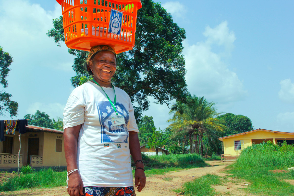 Kai Giba carries her basket of health products