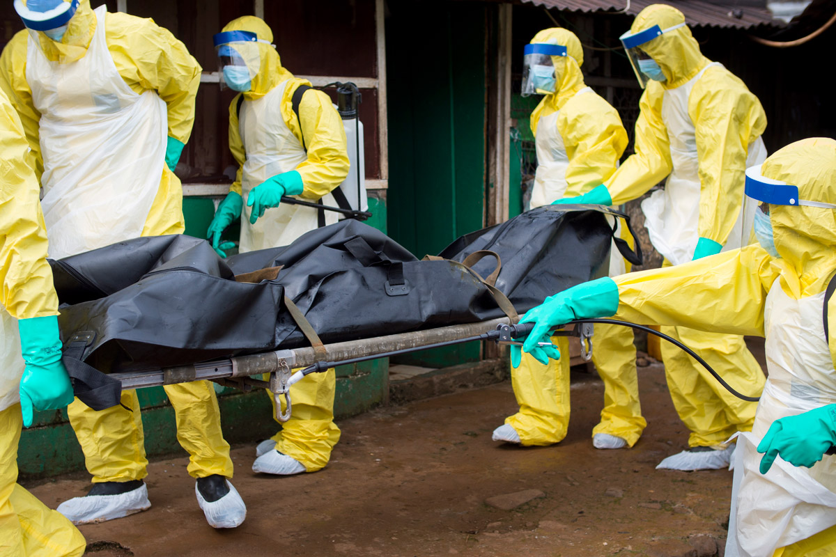 """Members of """"Burial Team 7"""" remove the body of a 44-year-old woman"""