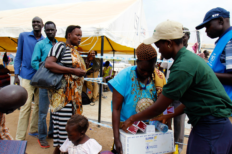 Concern Worldwide distributes water and high-energy biscuits in Tomping.