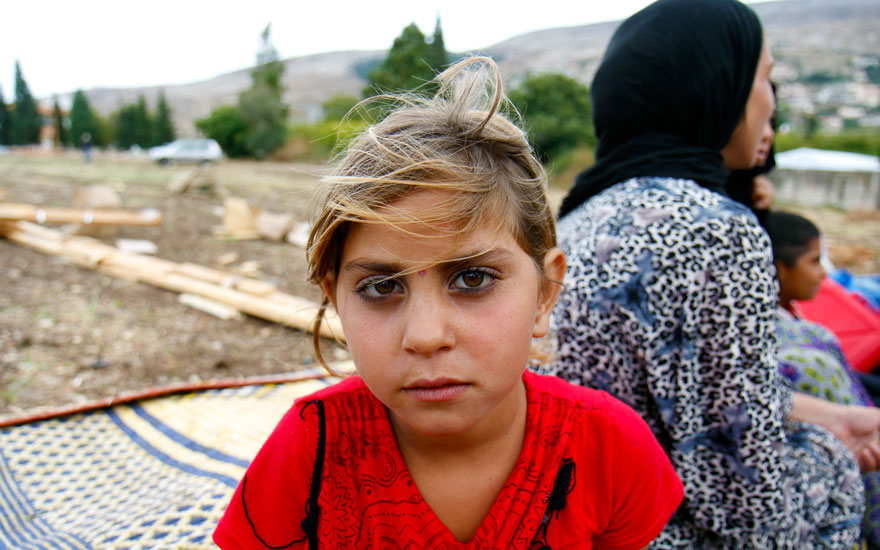 A Syrian refugee girl in an informal tented settlement near the Syrian border in Akkar district, north Lebanon. Some of the people living there were in the process of relocating to another area because they have repeatedly experienced cross-border shelling from Syria into Lebanon. Photo: Crystal Wells