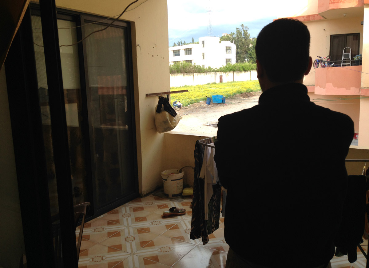 Ahmed looks out from his terrace