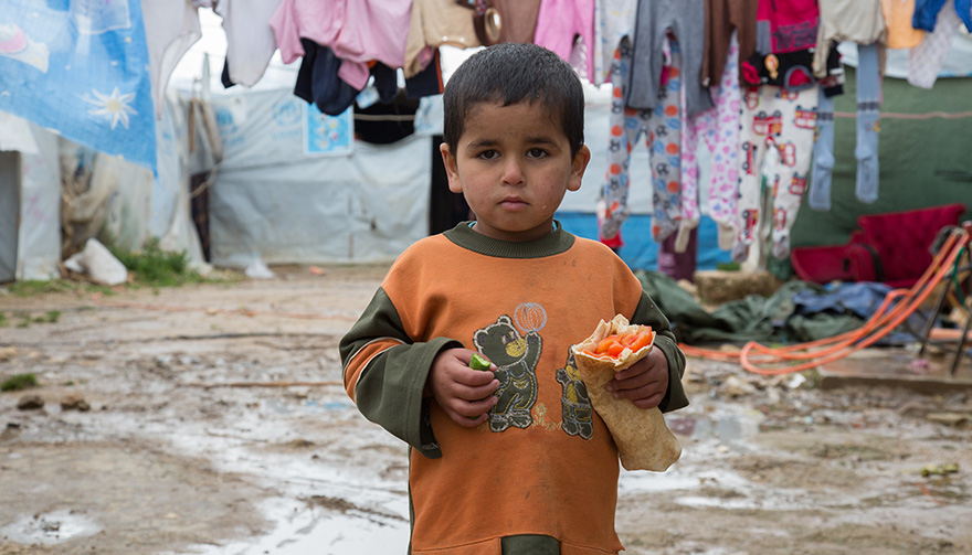 Samer, a four-year-old Syrian refugee, lives with his family in an informal tented settlement in Mohamara