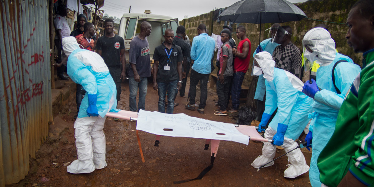 Members of Concern Worldwide burial team six remove the body of nine month old Aminata Samura