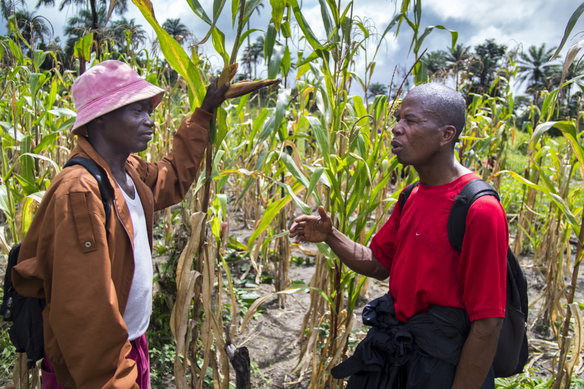 Maxim Howard (right), a Community Development Officer for Nutrition with Concern Worldwide, talks to one of the Farmer Field School leaders