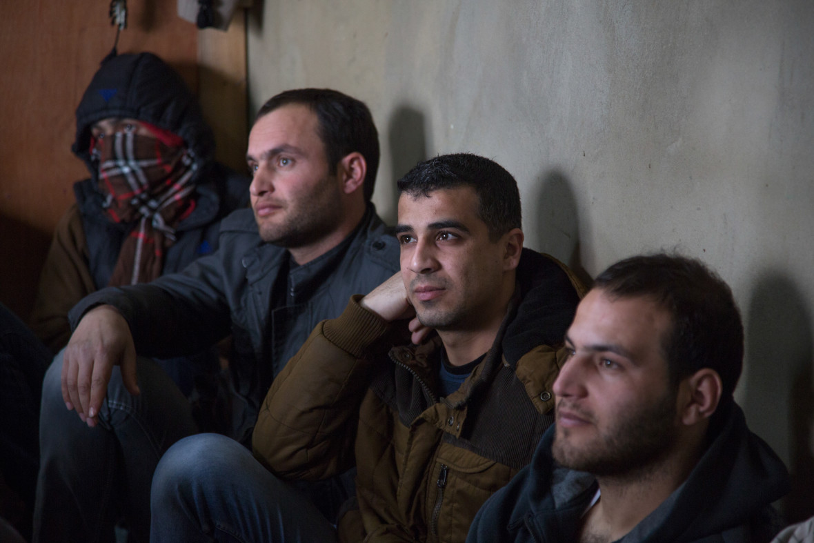 Syrian refugees listen to Concern Protection Field Officer Rami Fares