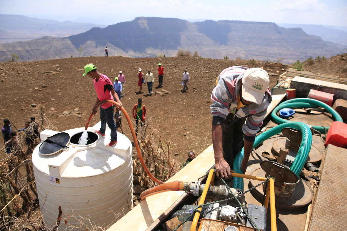 Concern Worldwide is trucking thousands of gallons of clean water to some of the most drough-affected communities in the Amhara region of Ethiopia. The valley in the background hasn't seen proper rain for three years and all water sources have dried up. Some people walk up to five hours a day to collect water. Photo: Kieran McConville