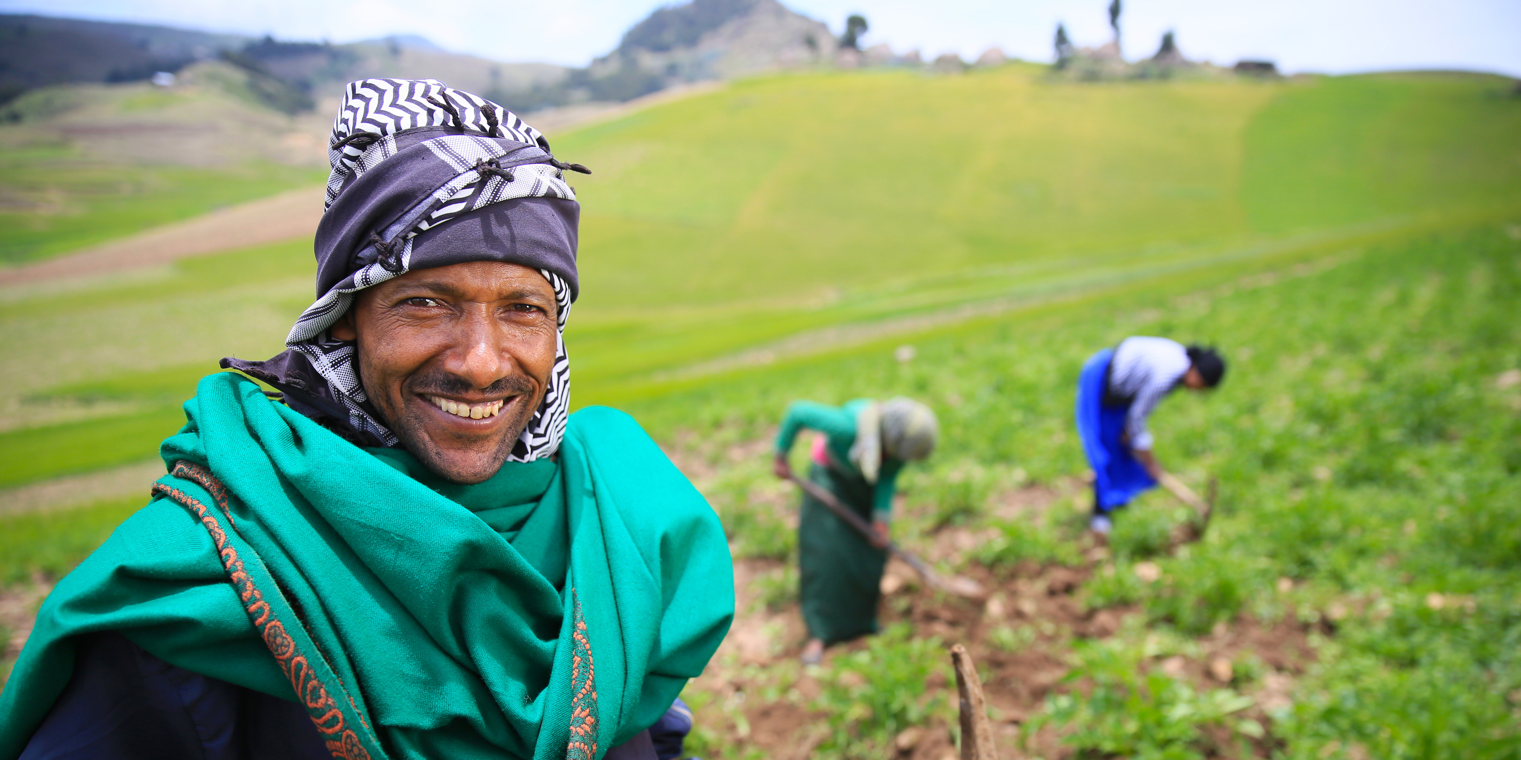 Ali Assen Ali, with two of his daughters, on their potato farm 12,000 feet up in the highlands of South Wollo, Ethiopia.