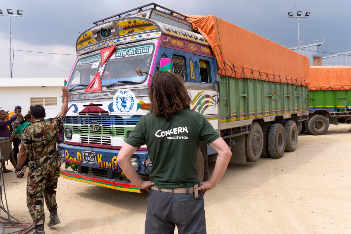 Concern logistician, Graham Woodcock, supervises the transfer of emergency relief supplies