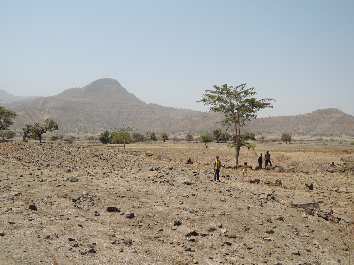 Child walk across barren fields