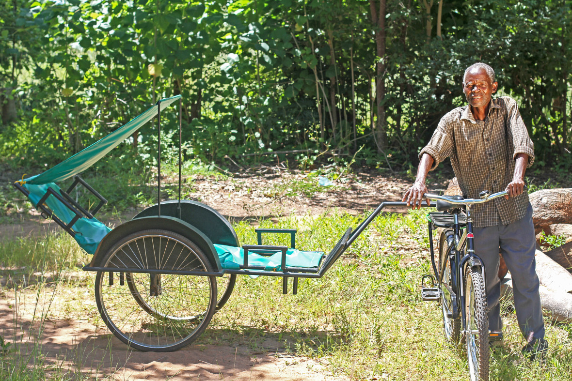 A man with a bicycle ambulance