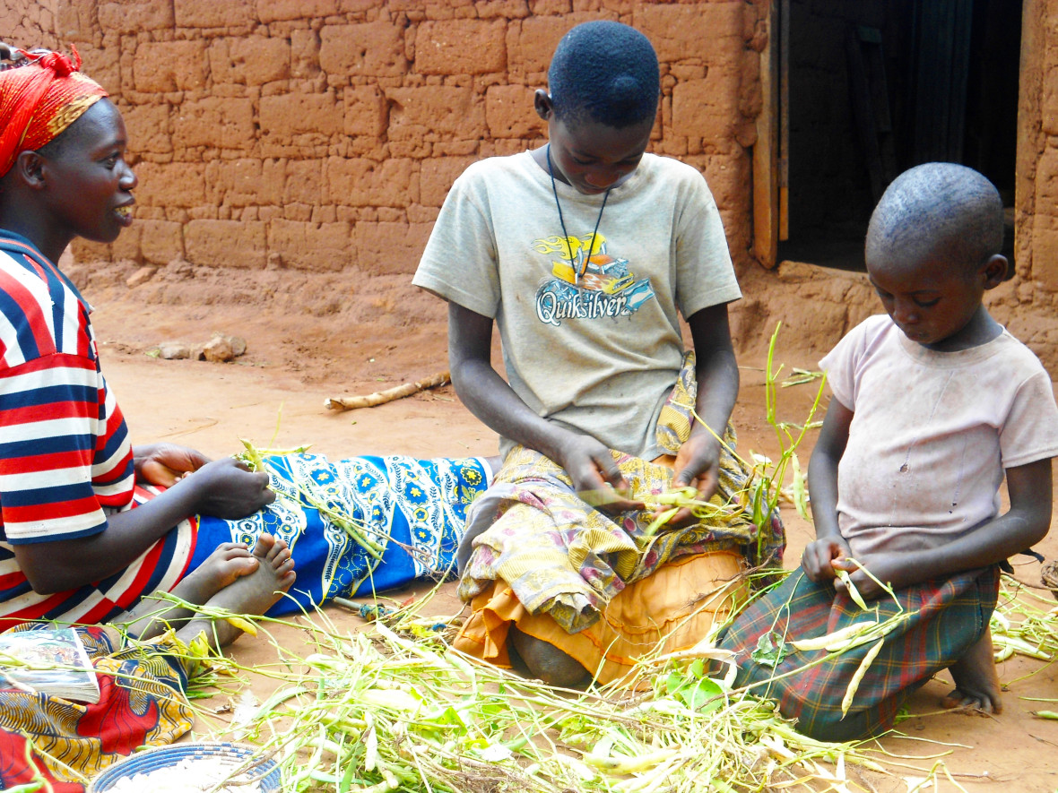 Elisabeth and her children, who help her with beans that they will eat and sell at market. Photo: Edward O Carroll