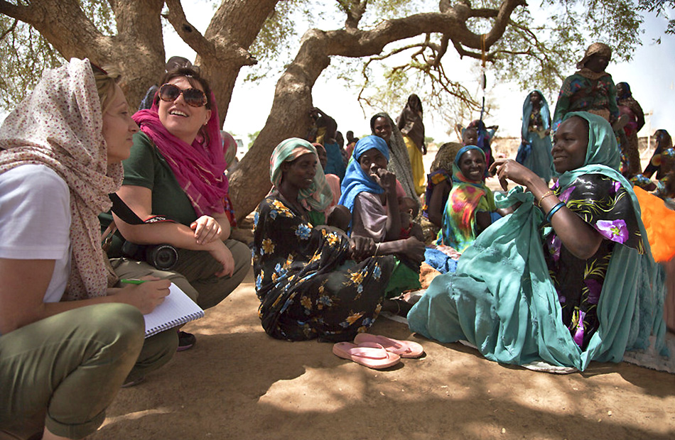 Concern's Vicki Wall and Jennifer Nolan with community members at Zabout health outpost, Goz Beida Subprefecture, Sila Region, Chad. Photographer: Oli Cohen, June 2014, Chad
