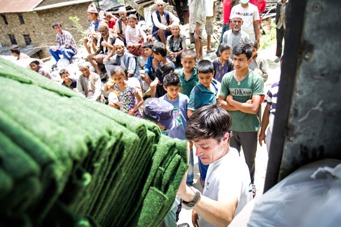 Concern's Kirk Prichard unloads carpets for a distribution in Talamarang, a village in Sindhupalchok district, one of the hardest hit areas by the 7.8-magnitude earthquake that struck Nepal on April 25, 2015.