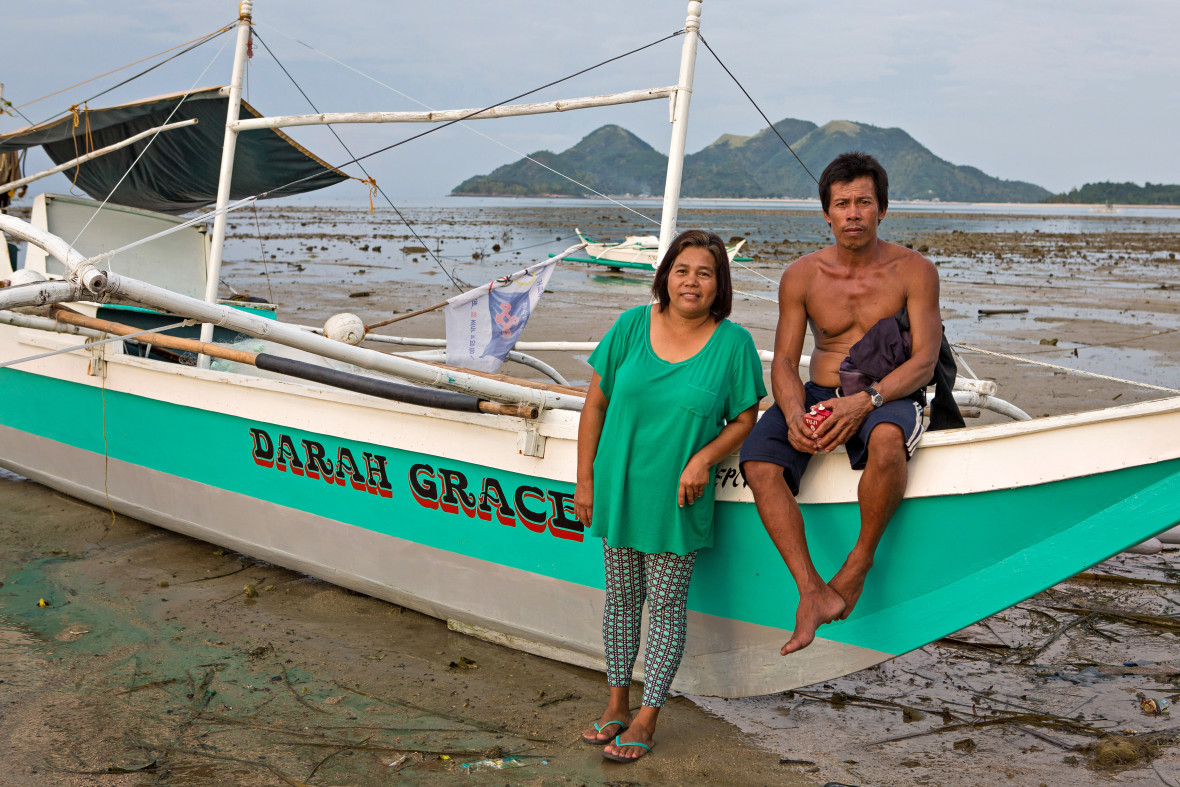Gildreth and Artem Abancio with their new boat in the Philippines