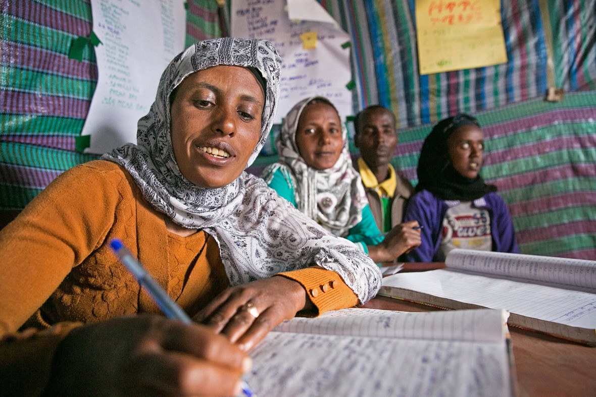 Tasam Haileselasie tracks contributions and withdrawals of local micro-loans in Megera, Ethiopia