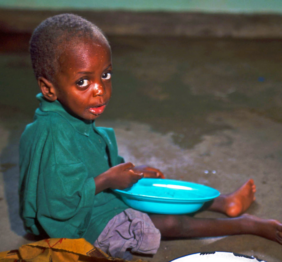 A young boy eating