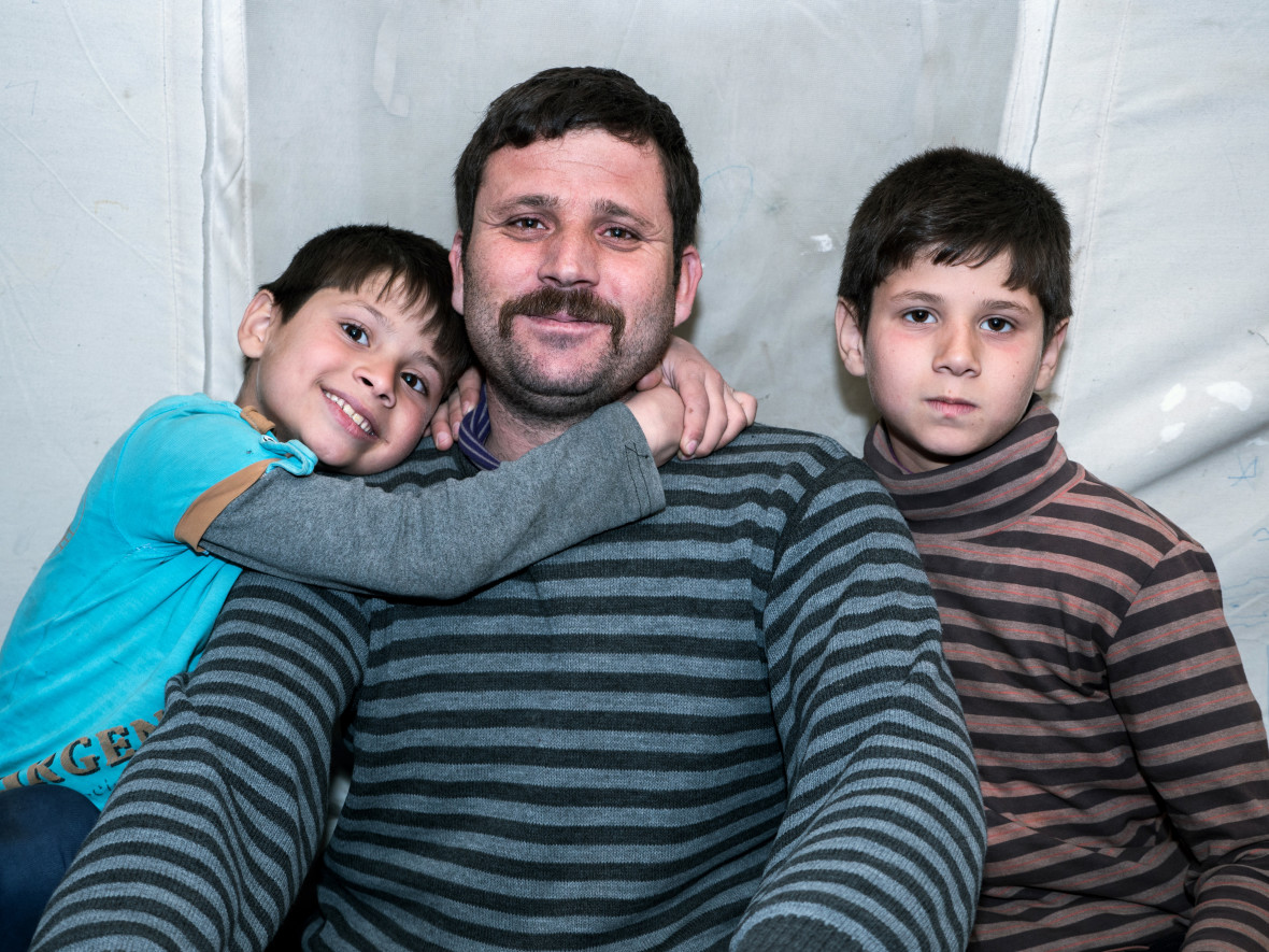 Abdullah Ahmadi with his two sons