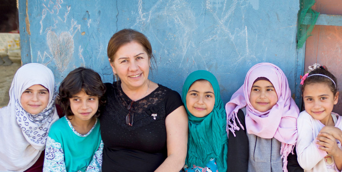 Maria Nader with Syrian children in an informal settlement in Lebanon