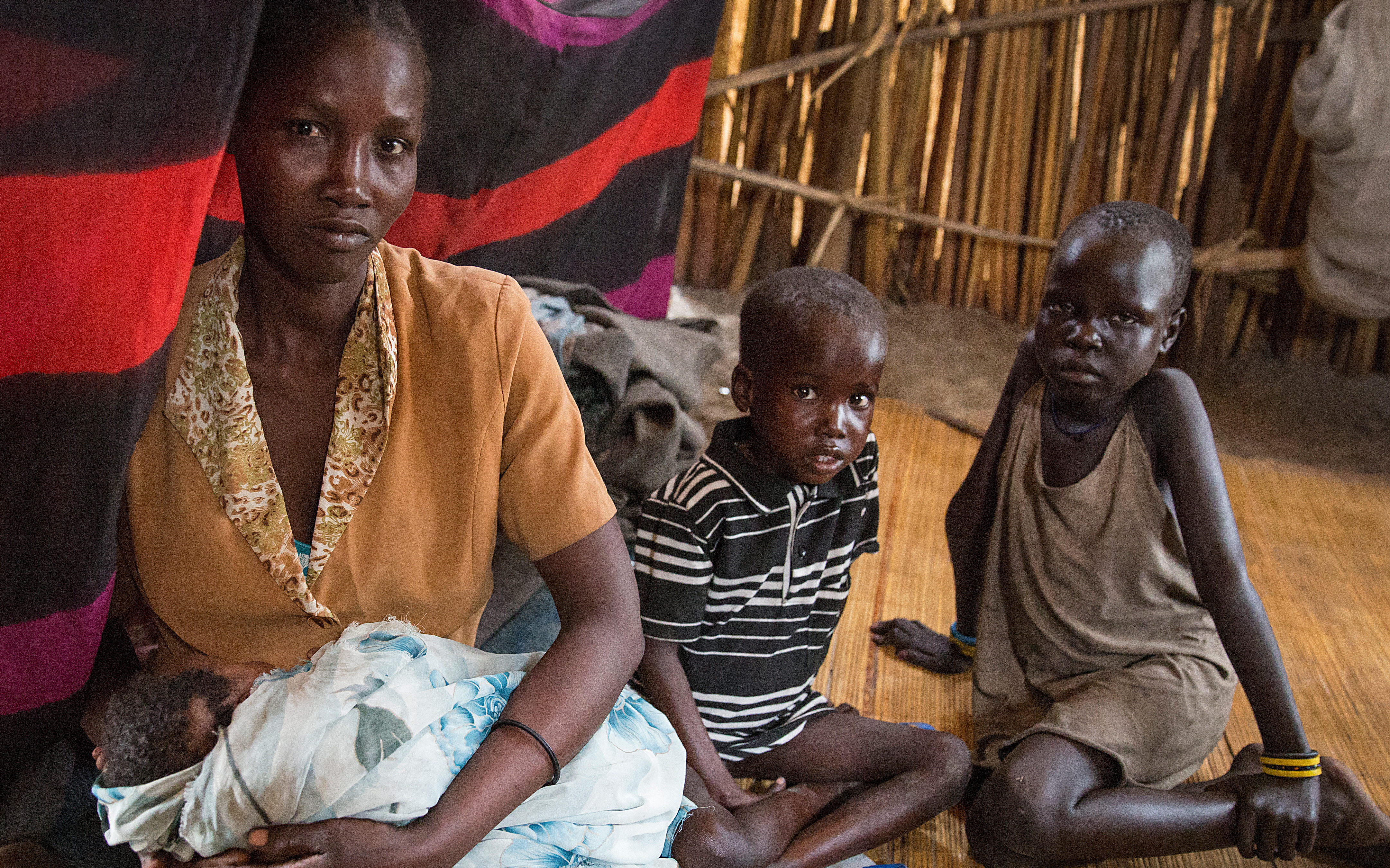 Idil and her children in their temporary home in Unity State, South Sudan