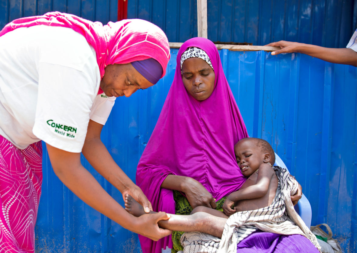 Aayan* with her three-year-old son, Aaden*, at Concern Worldwide's nutrition center in Mogadishu, Somalia