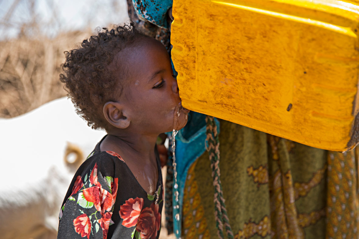 young girl drinks water in Somaliland