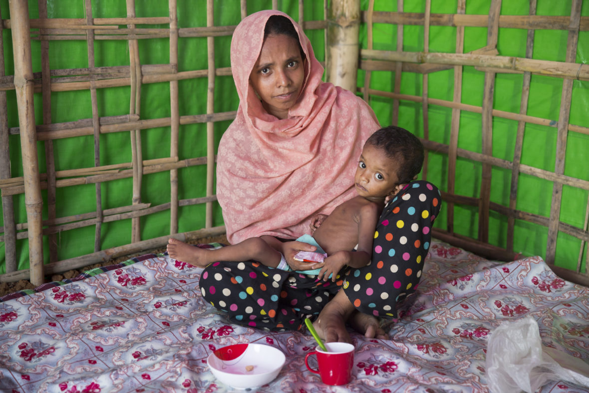 Layru* and her two-year-old daughter Hala* at a Concern nutrition support center at Hakim Para camp in Bangladesh.