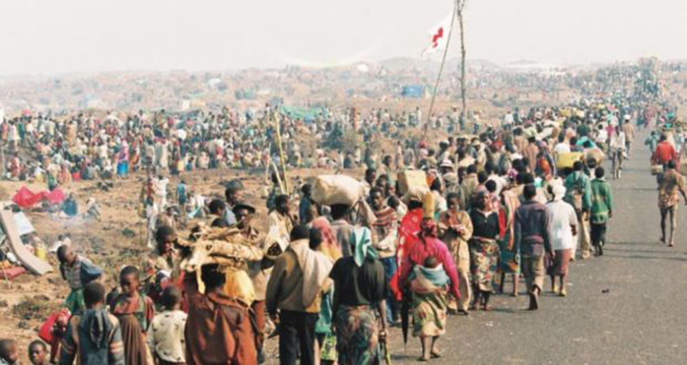 Refugees walking along the crowded road to Goma, Zaire carrying their possessions