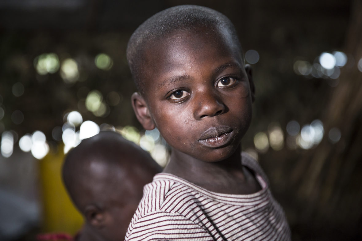 Feza Angelique, age 10 years, in her temporary accommodation at a school in Katale village