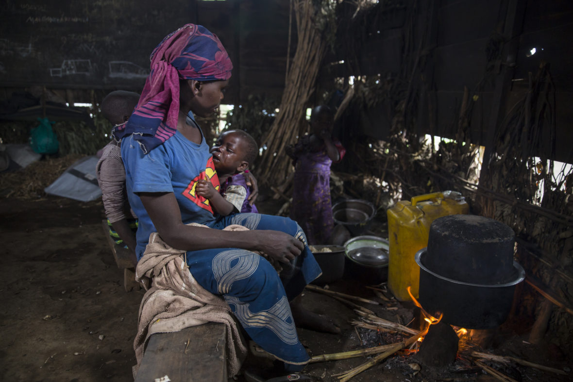 Woman holding baby in a displacement camp