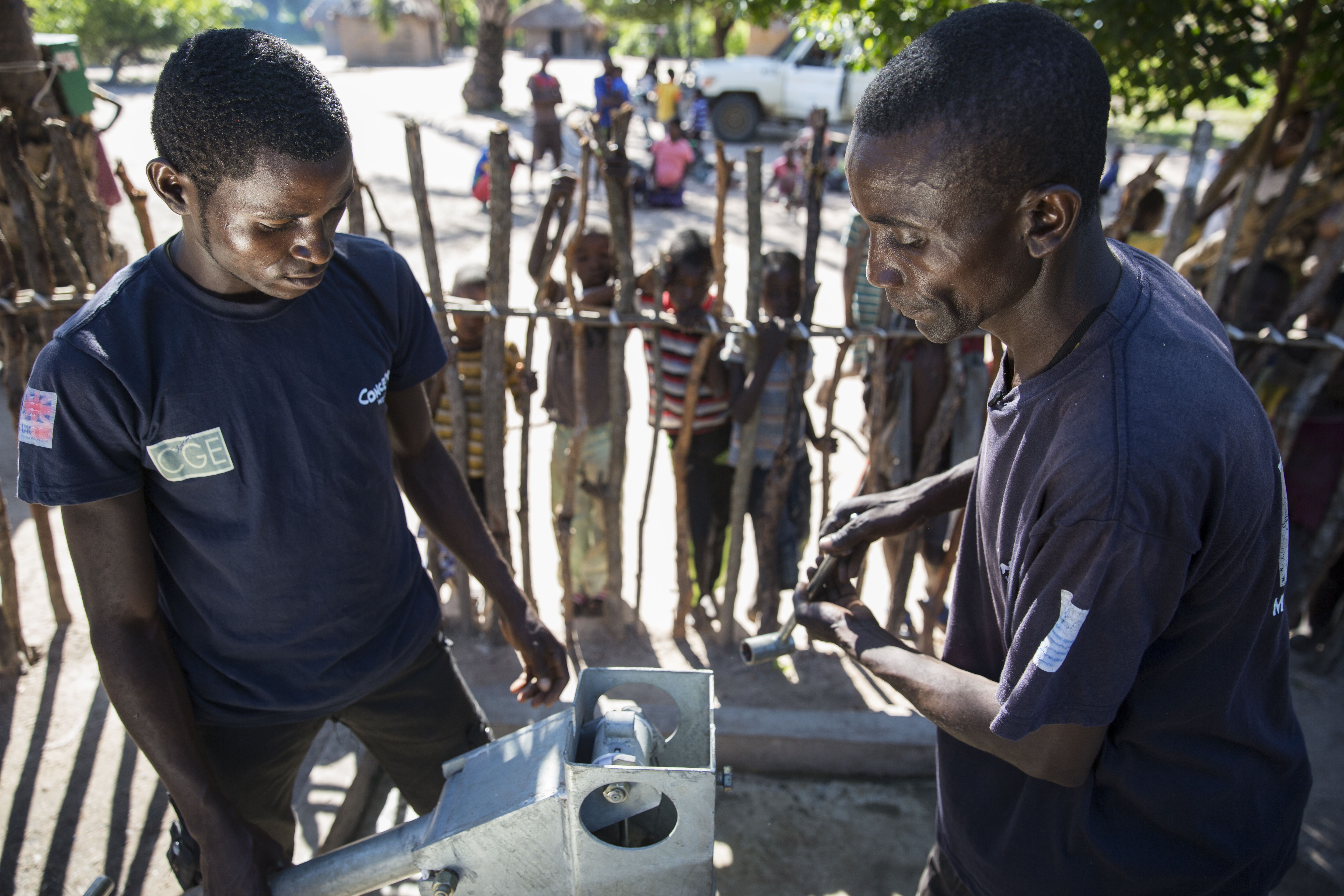 A maintenance team works on the water pump