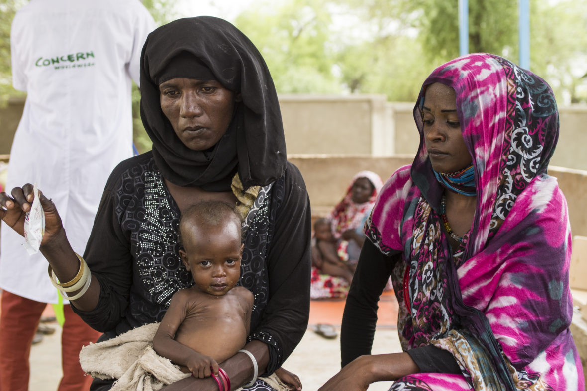 Two women and an infant at a health clinic in Chad.