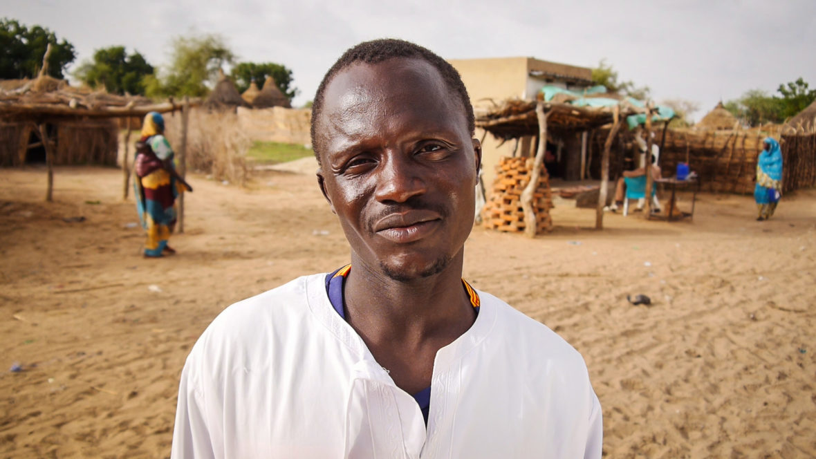 Man standing in street of town in rural Chad