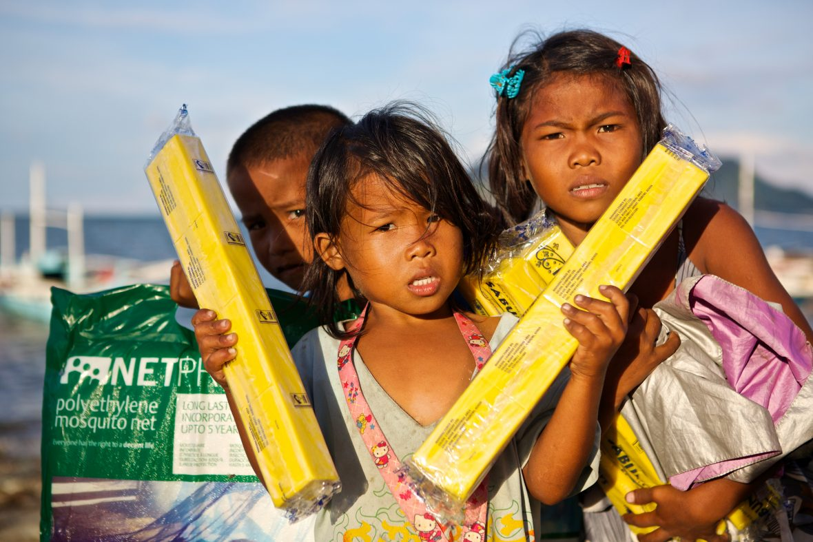 Kids in the Philippines with non-food items that were distributed by Concern