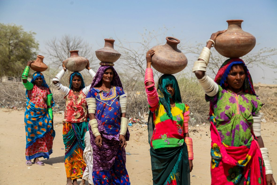 Women in Pakistan go to fetch water