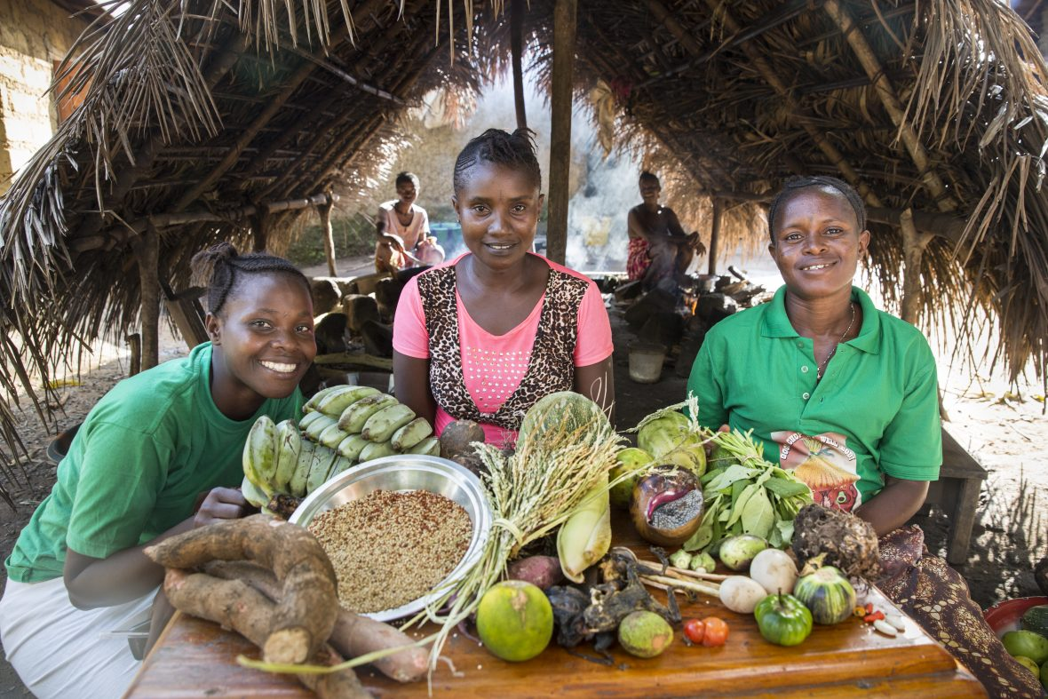 Members of the community committee in Bongay village, Sierra Leone, proudly display the range of foods they're now growing and foraging for.