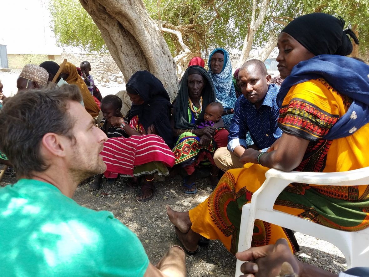 Photographer Alexi Lubomirski in a Community Conversations group in Kenya