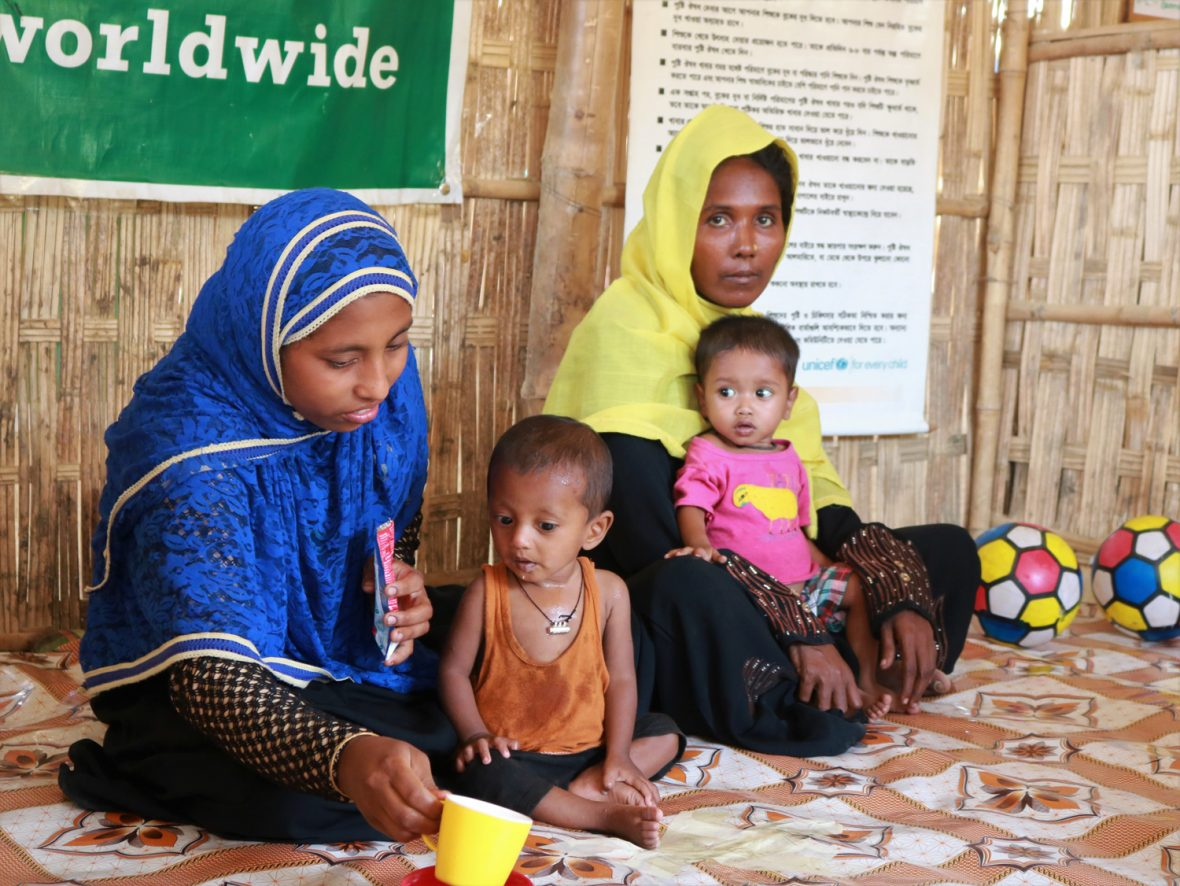 Womena and children at nutrition center in Bangladesh